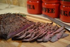 Barbecued flank steak, thinly sliced across the grain.