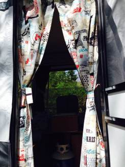 Tilly's newly sewn 'anti-bug' door in vintage-style VW fabric
