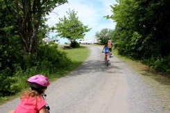 Cycling Loop A, which starts wooded and then opens into a field overlooking the beach.