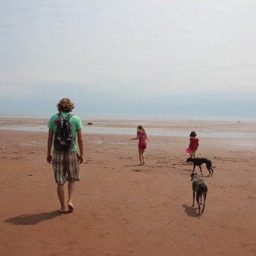 Red sand beaches at Cape Blomidon while glamping at Blomidon Provincial Park.