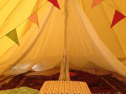 Bell tent lounge with an inner mesh tent.