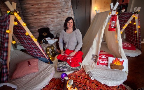 Cyndi Sweeney, owner of East Coast Glamping, displays some of the Camp Glamp supplies in her home on Wednesday.